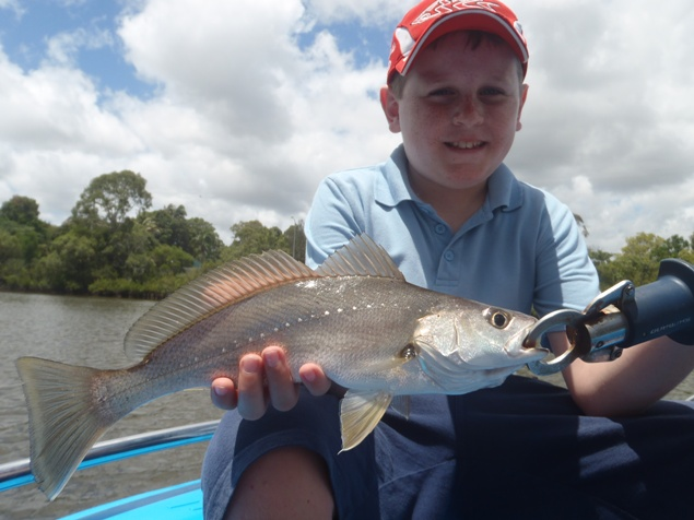 Lachlan_Moulds_With_A_Juvenille_Maroochy_River_Jewfish